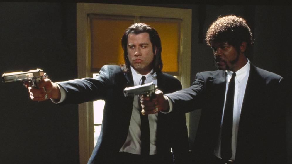 Izquierda: Vincent Vega (John Travolta), Derecha: Jules Winnfield (Samuel L. Jackson) en Pulp Fiction, los dos mafiosos característicos.